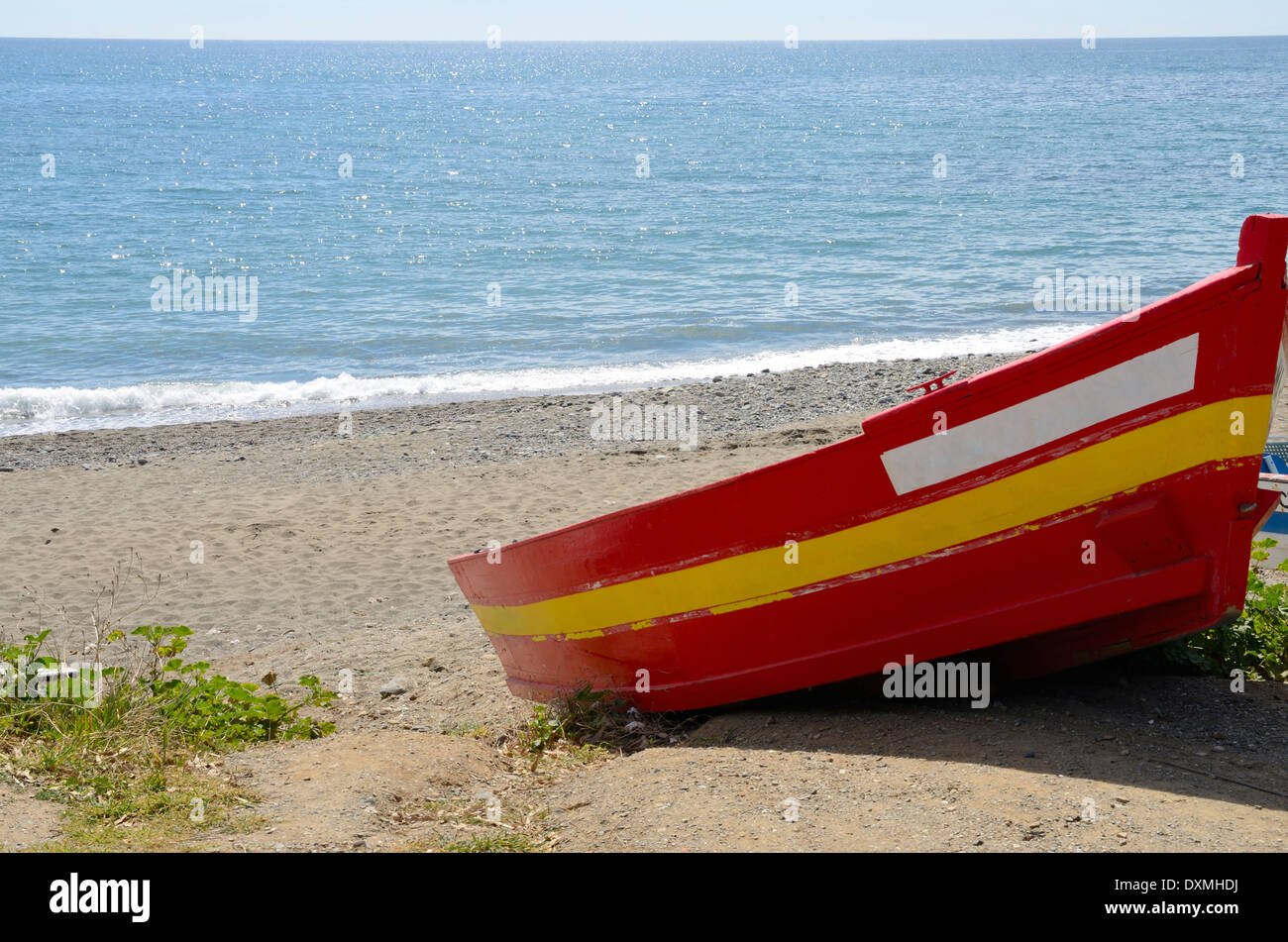 Fishing boat painted with the colors of the Spanish flag in the ...