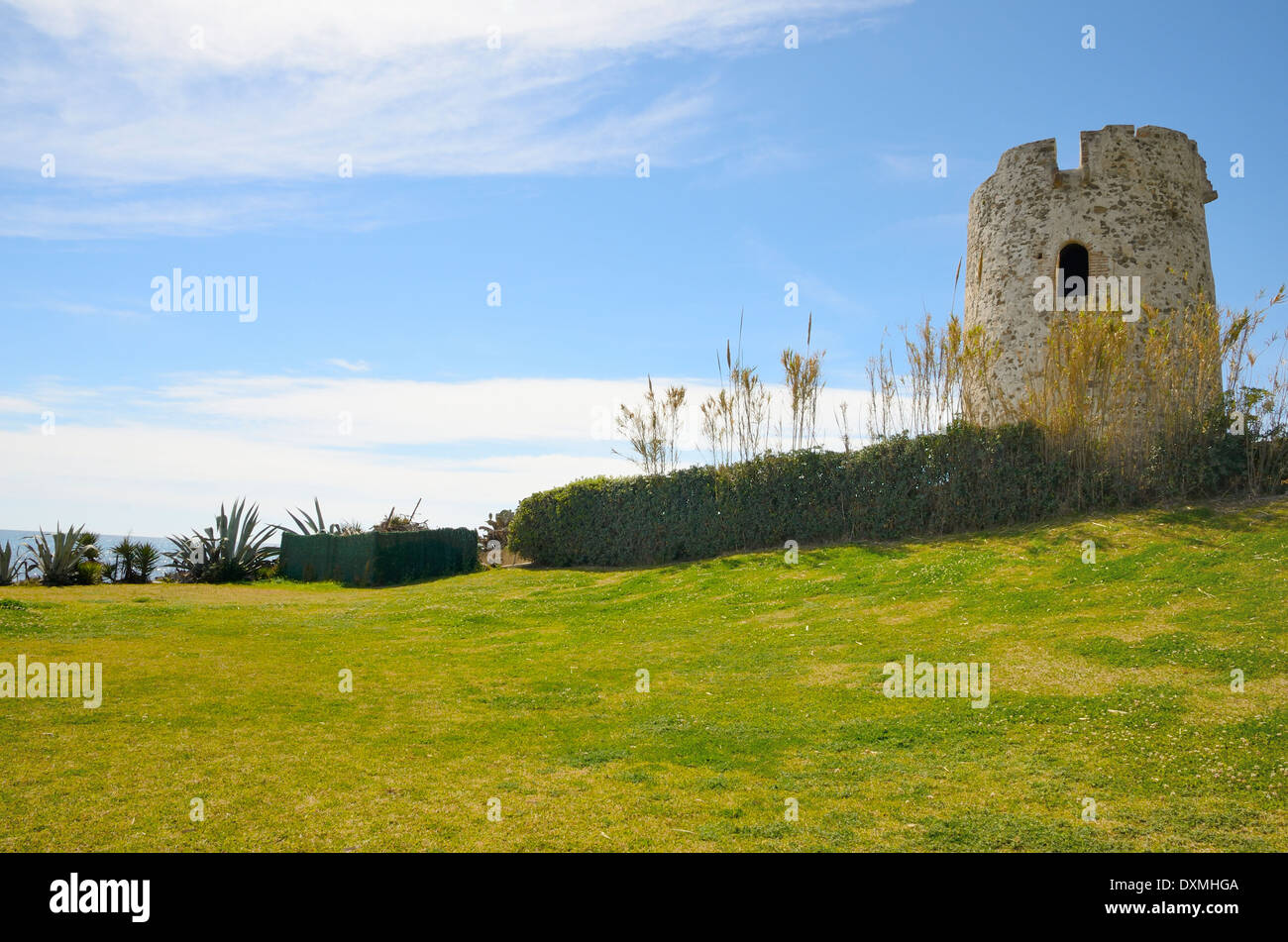 Old Stone tower next to the sea in Marbella, Andalusia, Spain - Stock Image