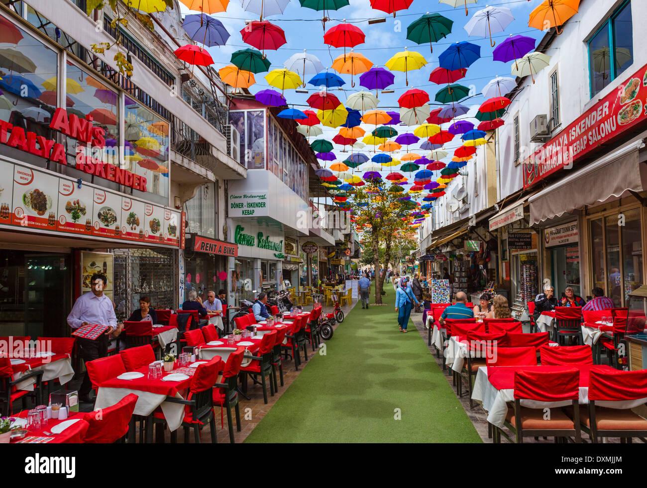 Restaurants on Umbrella Street (2 Inonu Caddesi), Kaleici, Antalya, Turkey - Stock Image