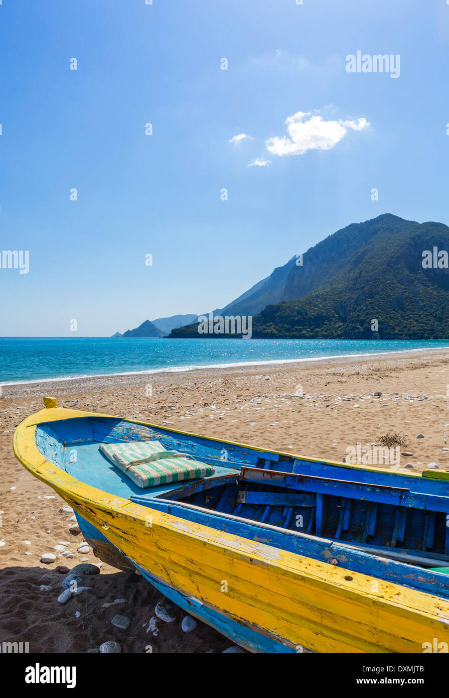Beach in the quiet resort of Cirali looking towards the ruins at Olympos, Kemer District, Antalya Province, Turkey - Stock Image