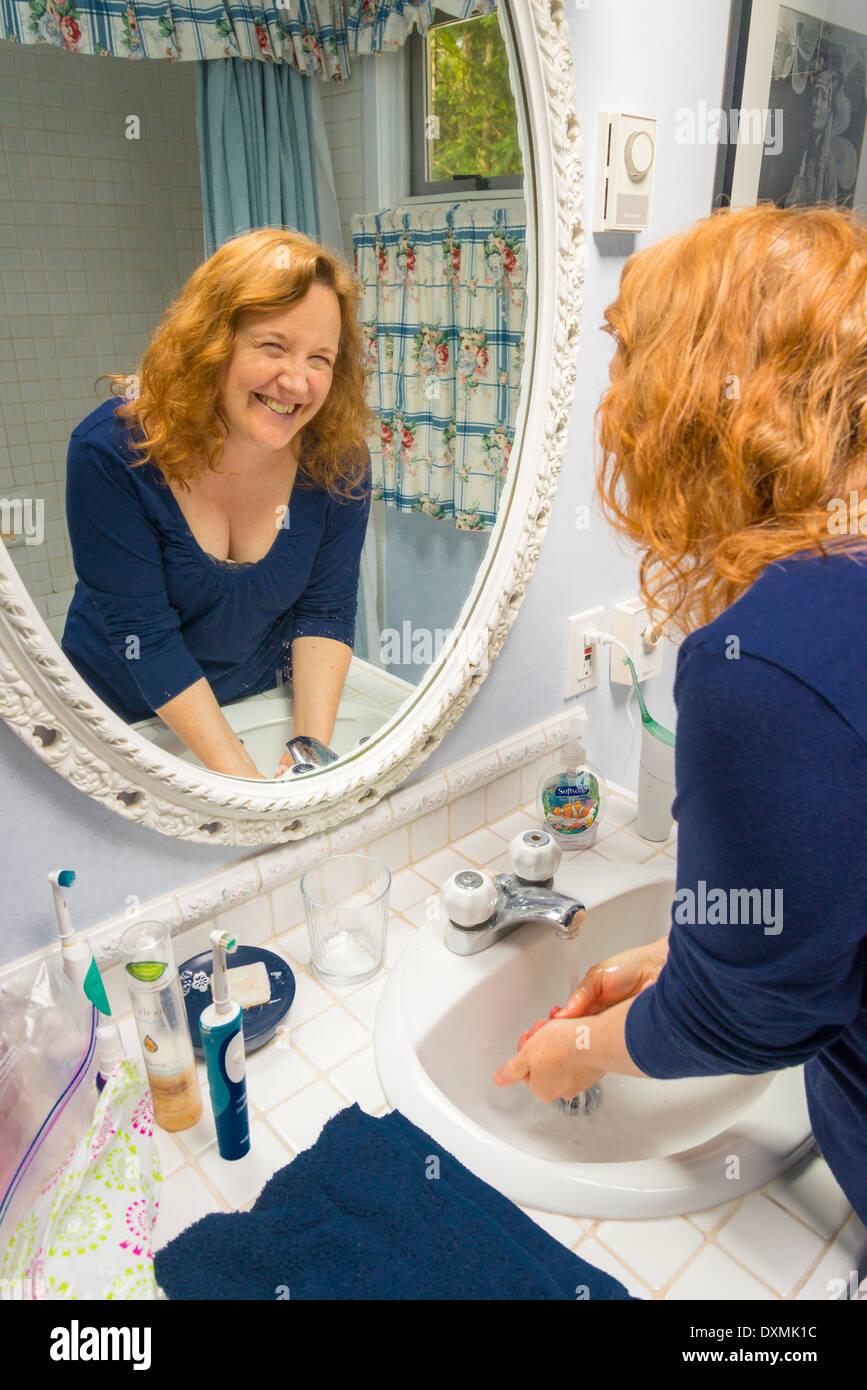 woman washing hands - Stock Image