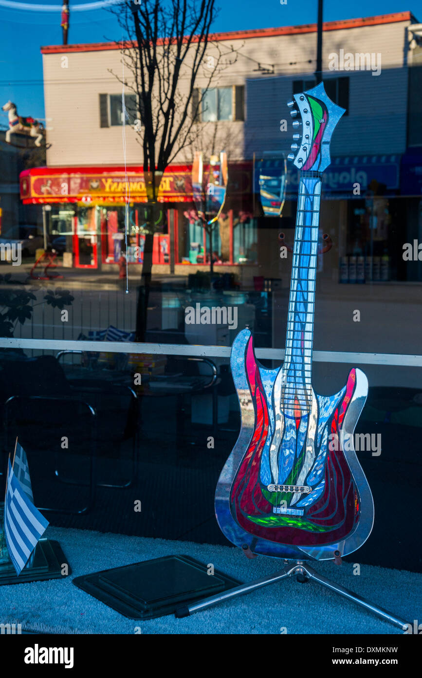Electric guitar in shop window, Vancouver, British Columbia, Canada - Stock Image
