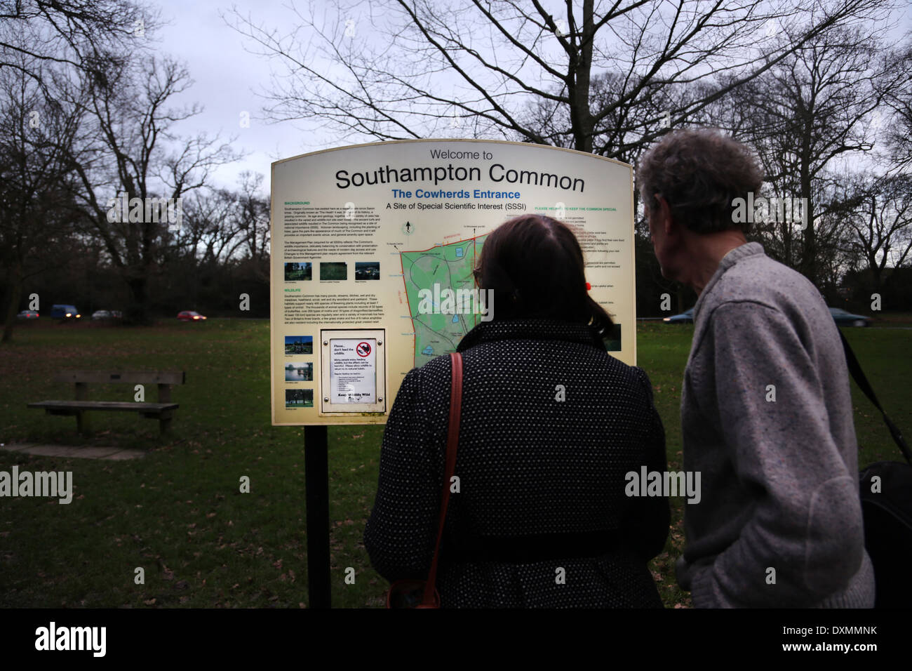 Hampshire England Southampton Common Man And Woman Looking At Cowherds Entrance Sign Site Of Special Scientific Interest (SSSI) - Stock Image