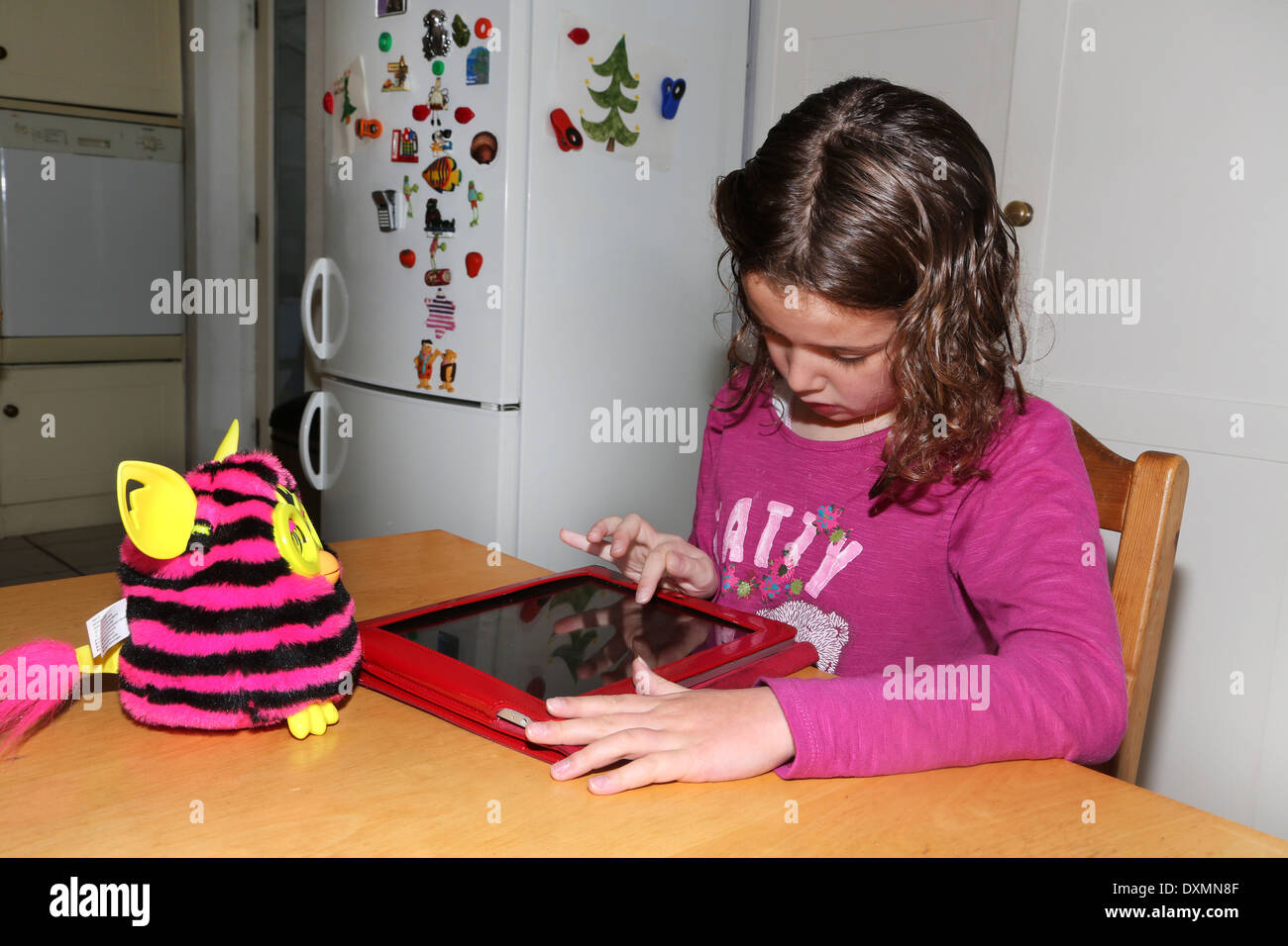 Incredible 8 Year Old Girl Using An Ipad With Furby On The Table Surrey Download Free Architecture Designs Terchretrmadebymaigaardcom