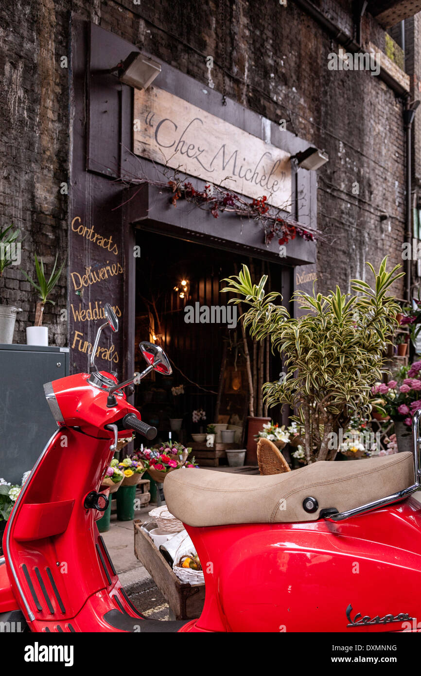 Red moped and flowers shop,Borough Market,London,England - Stock Image