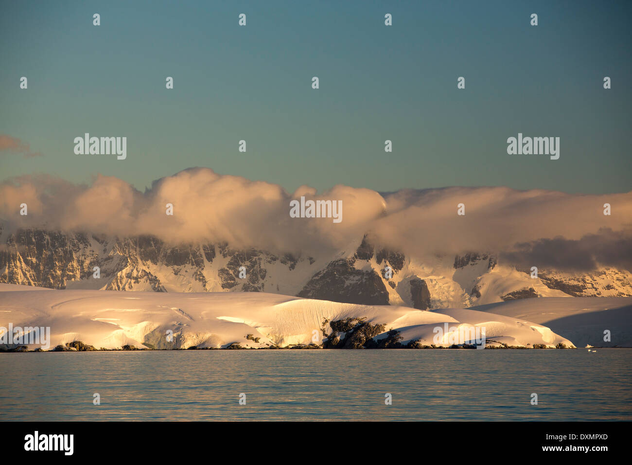 Evening light over mountains from the Gerlache Strait separating the Palmer Archipelago from the Antarctic Peninsular Stock Photo