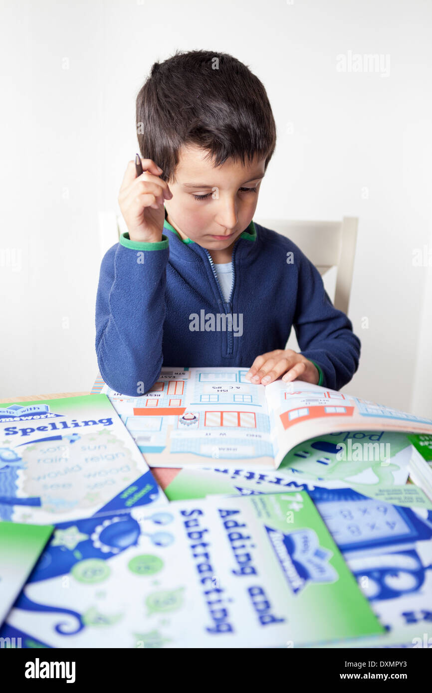 Young Schoolboy-6-7 years old learning at home - Stock Image