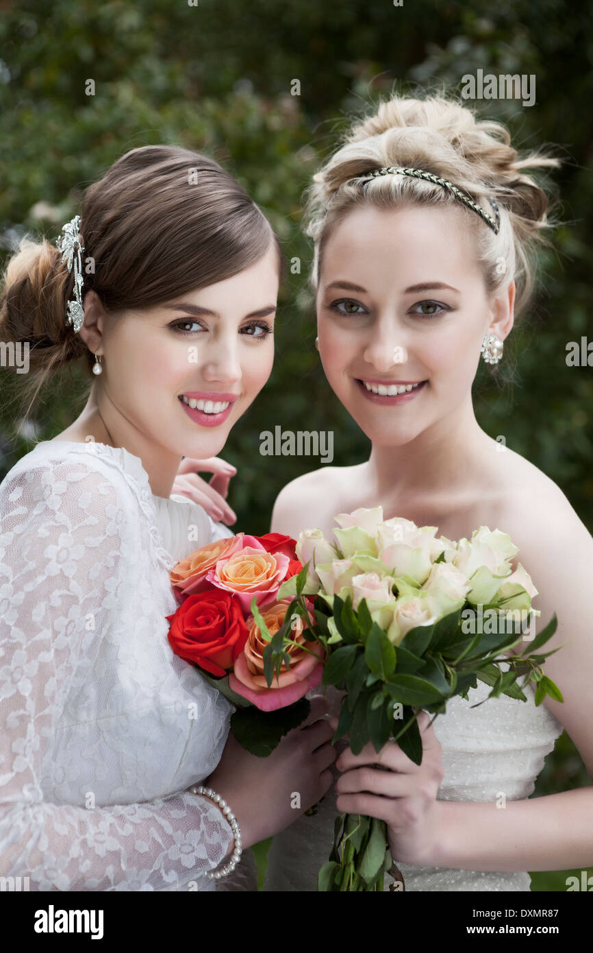 Two happy brides with flowers - Stock Image