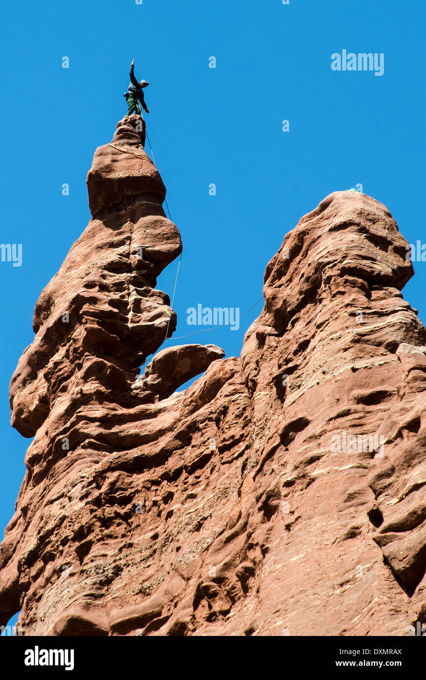 Rock Climbers on Fisher Towers Moab Utah USA - Stock Image