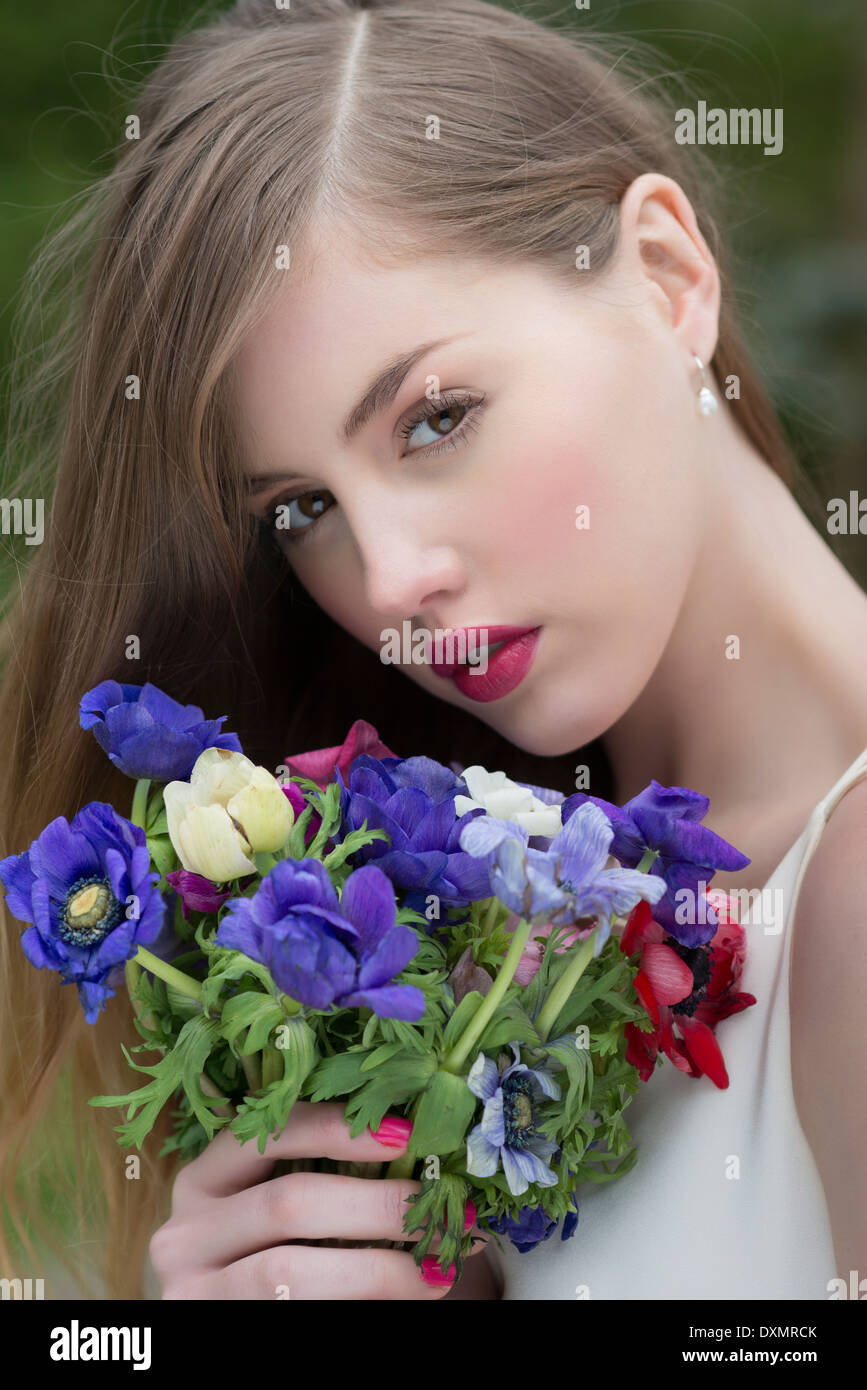 Girl with wild flowers bouquet - Stock Image