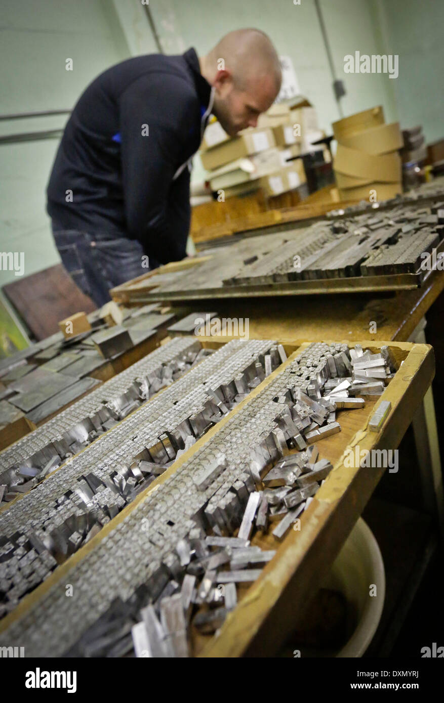 Vancouver, Canada. 27th Mar, 2014. An antique collector looks for assorted Chinese typeset characters at Ho Sun Hing Printers in Chinatown in Vancouver, Canada, March 27, 2014. After more than 100 years in business and three generations of family, Ho Sun Hing Printers in Chinatown will close this Friday. The company which opened in 1908 is the first Chinese print shop in Canada. © Liang Sen/Xinhua/Alamy Live News - Stock Image