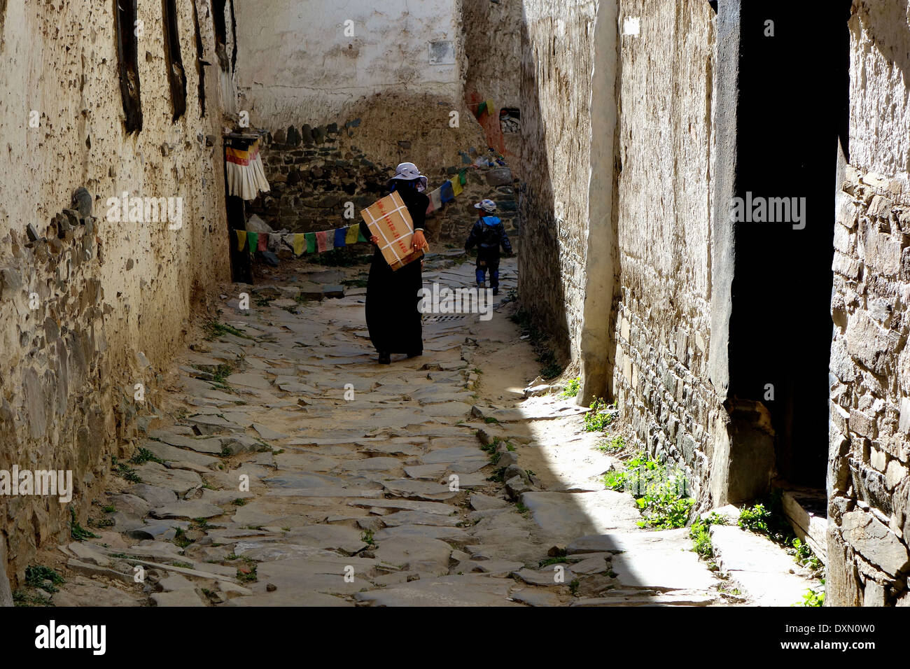 Tibetan People,walking  in old street of Lhasa,Candid street photography,Life of Buddhist devotion - Stock Image