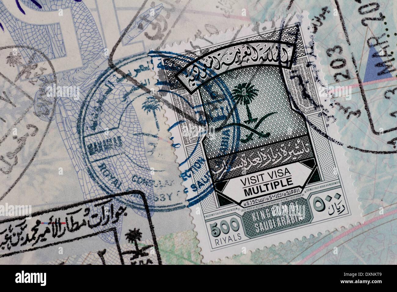 Saudi multiple entry visa stamp in British passport - Stock Image