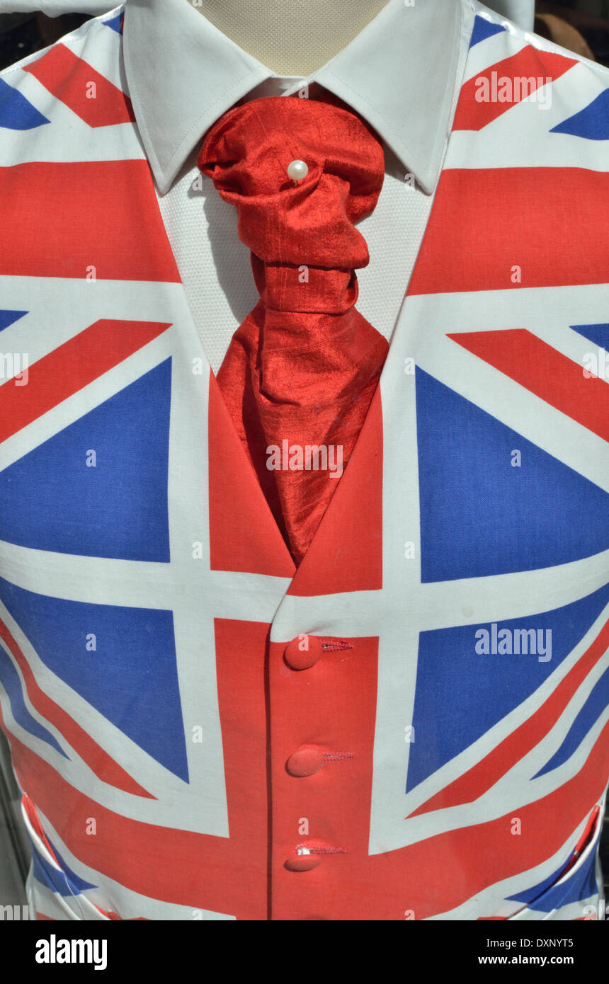 Union Jack waistcoat with red tie and white shirt on display in a UK shop window - Stock Image