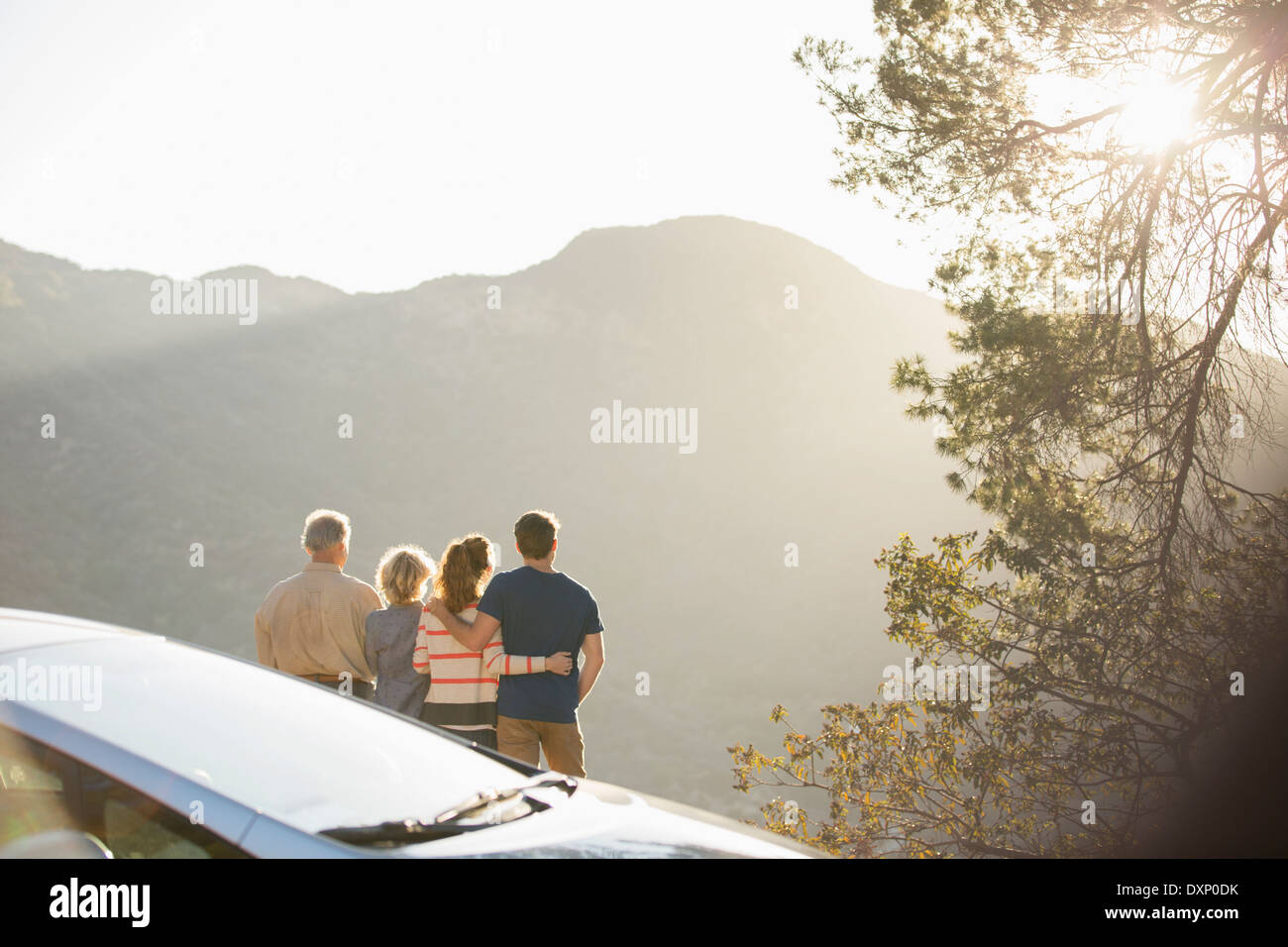 Family looking at mountain view outside car - Stock Image