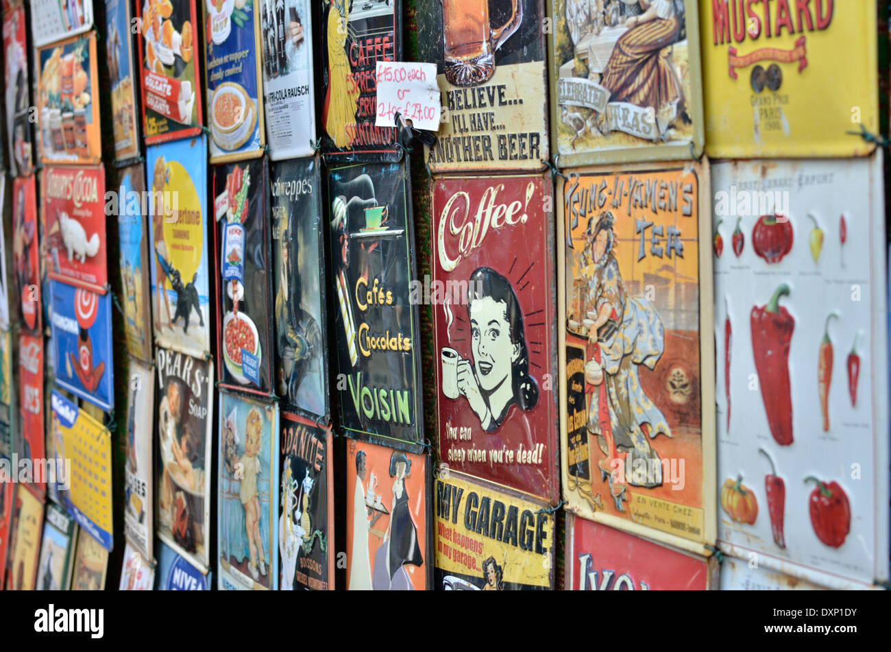 Old tin sign product advertisements, Portobello Road, Notting Hill, London, UK. - Stock Image
