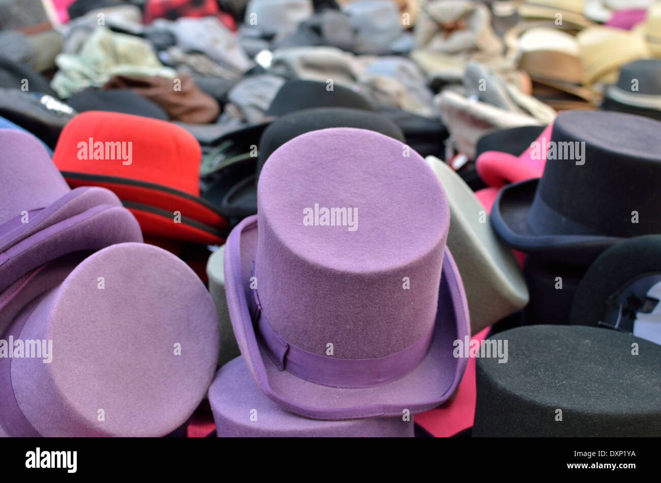 Top hats on display on a market stall, Portobello Road, Notting Hill, London, UK - Stock Image