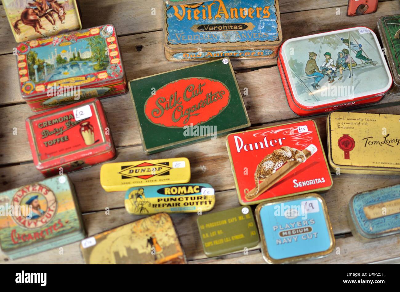 Colourful old tin boxes on a market stall, Portobello Road, Notting Hill, London, UK. - Stock Image