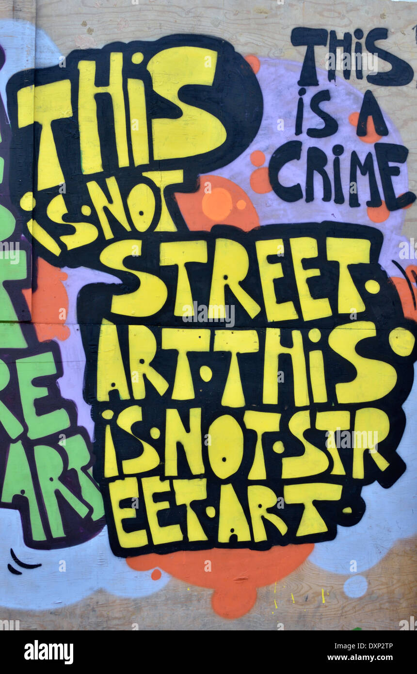 Graffiti on a wall reading: 'This is not sreet art. This is a crime', London, UK - Stock Image