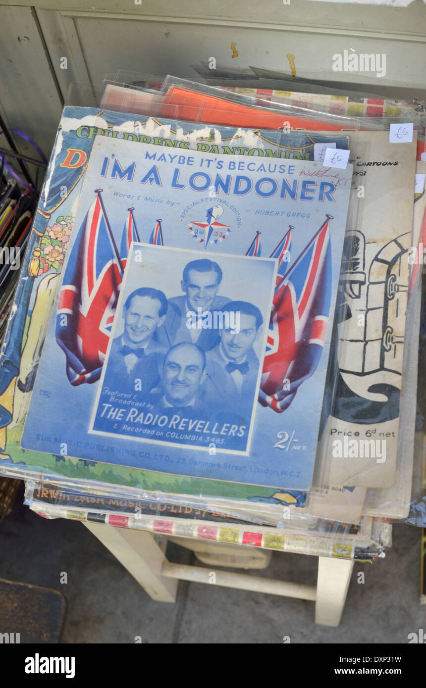 Old songbook for 'Maybe It's Because I'm a Londoner' displayed outside a junk shop, London, UK - Stock Image