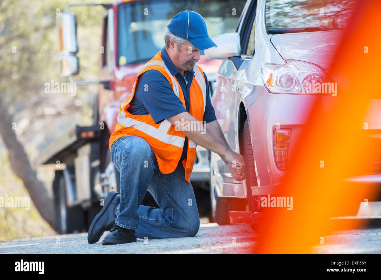 Roadside mechanic repairing flat tire Stock Photo