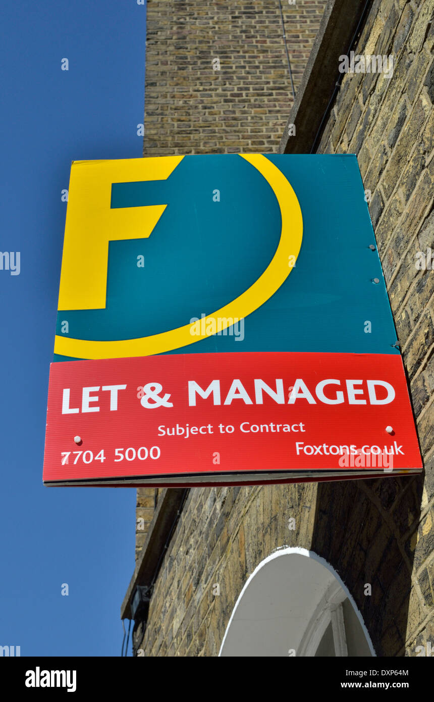 Foxtons Let and Managed estate agent sign outside a house, Islington, London, UK. - Stock Image