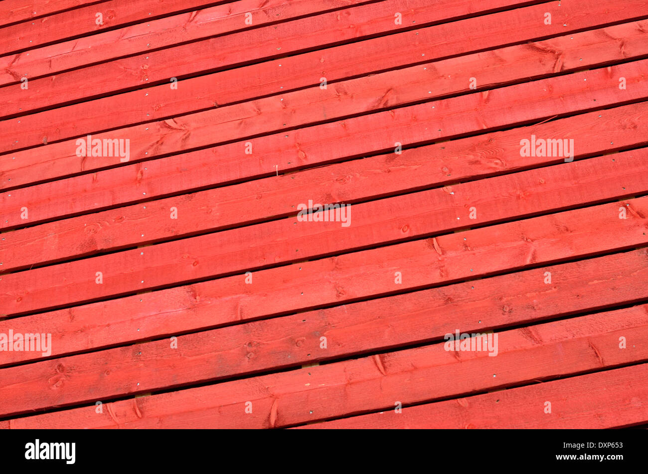 Close-up of orange painted wooden fence - Stock Image