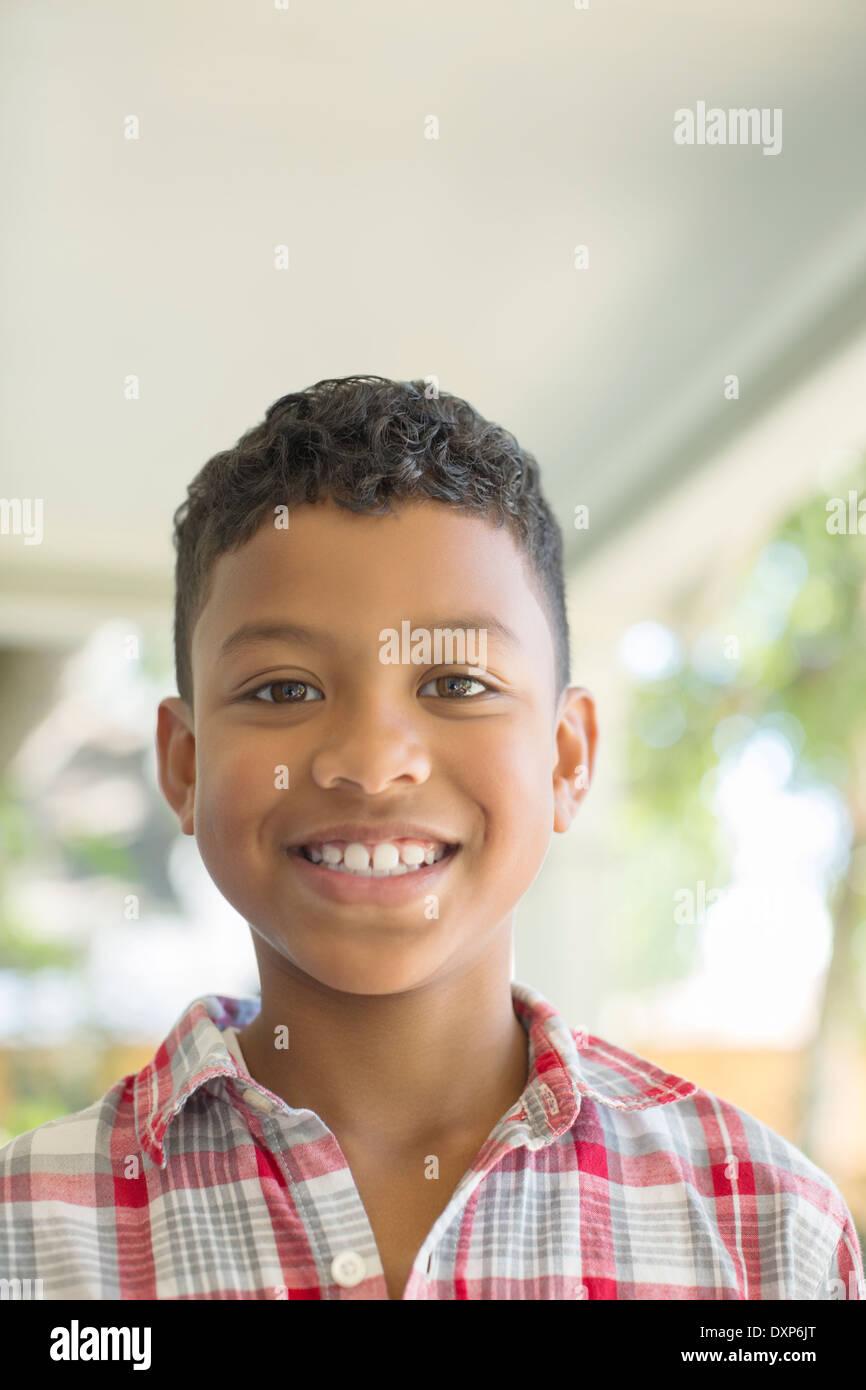 Close up portrait of smiling boy - Stock Image