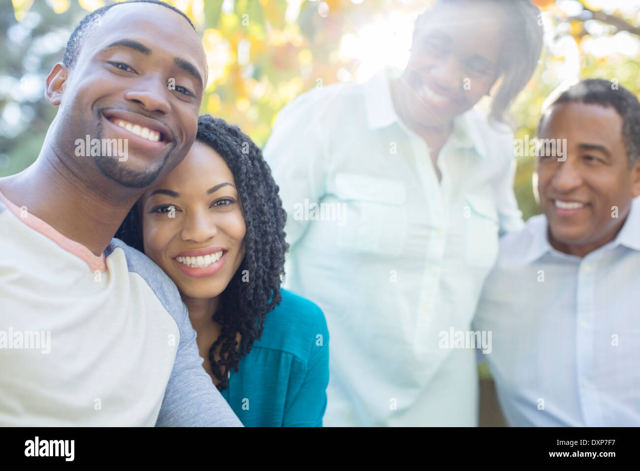 Portrait of smiling couple with parents - Stock Image