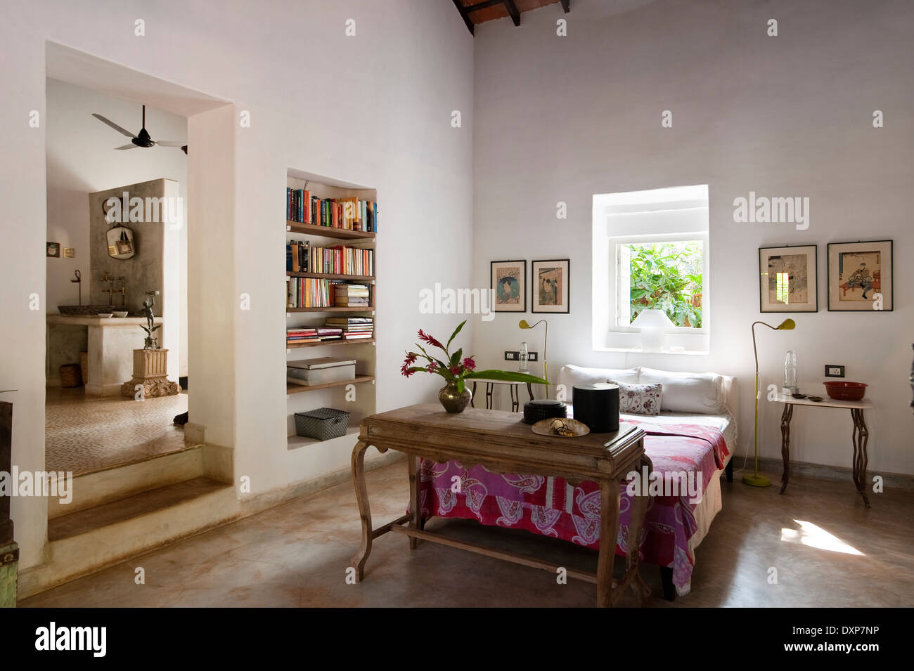 Open plan bedroom interior with recessed shelving in the Indian state of Goa - Stock Image