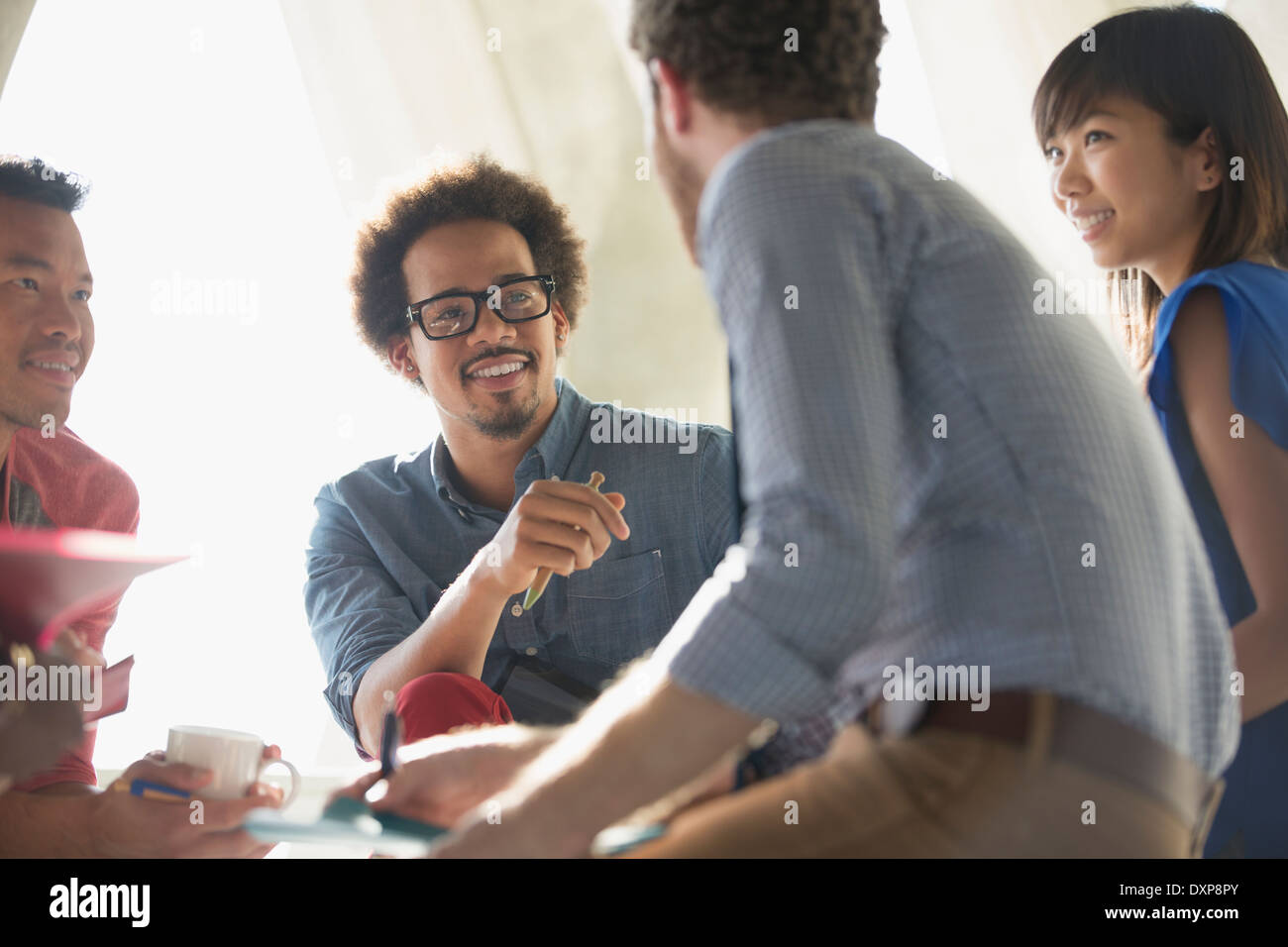 Casual business people talking in meeting - Stock Image