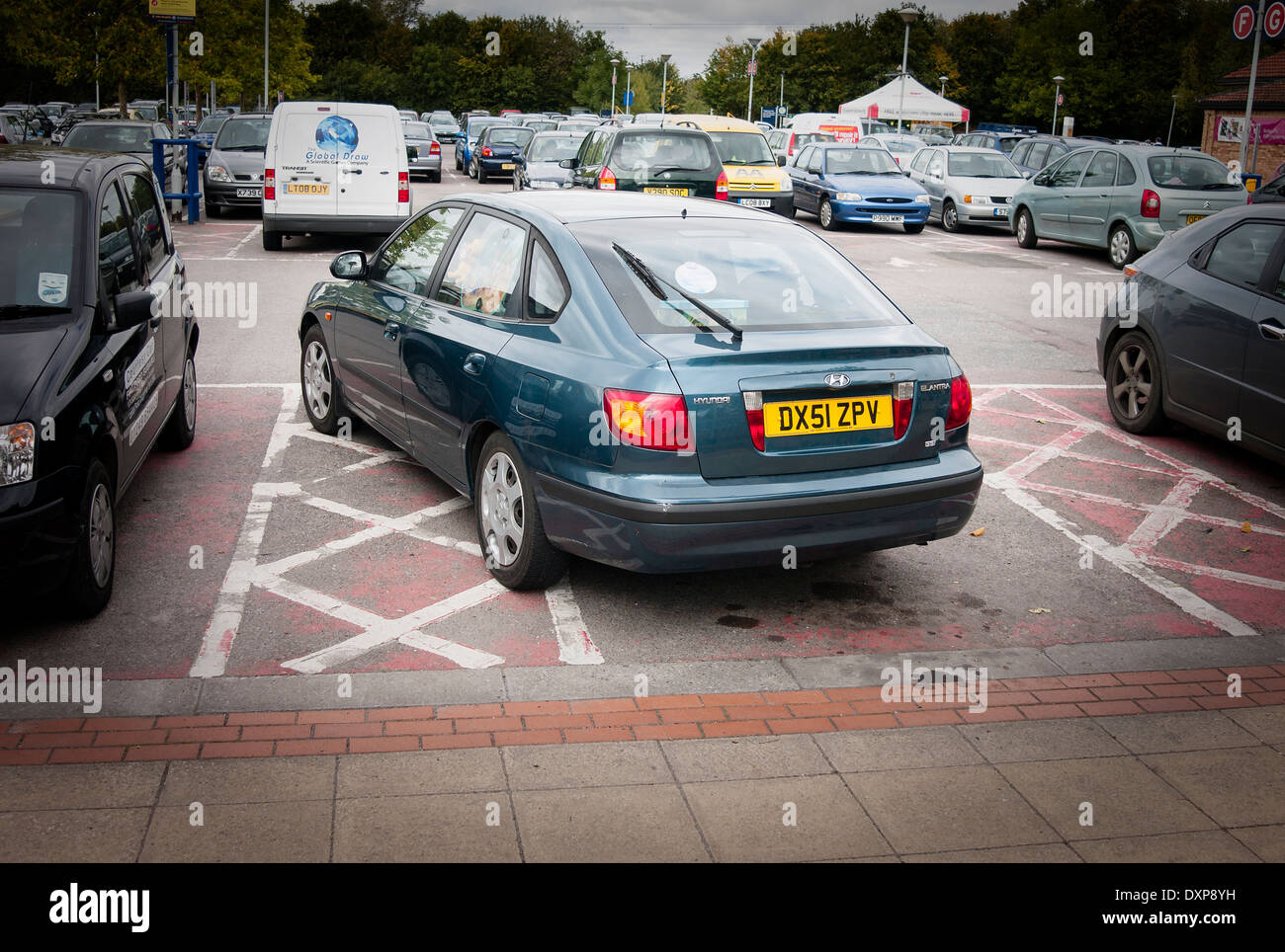 Badly parked car in disabled bay in supermarket car park - Stock Image