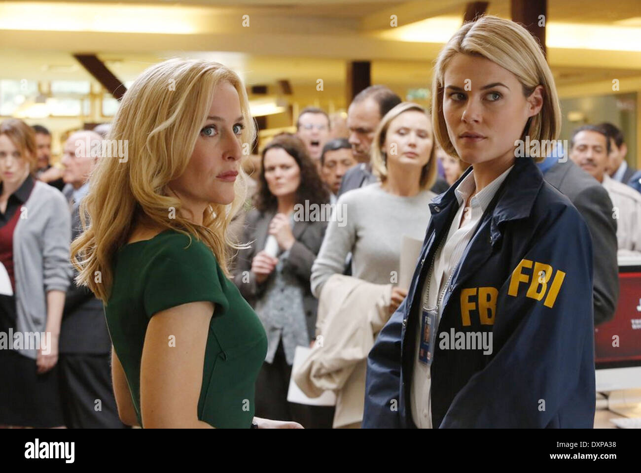 CRISIS 2013 NBCUniversal Media film with Gillian Anderson at left and Rachael Taylor - Stock Image