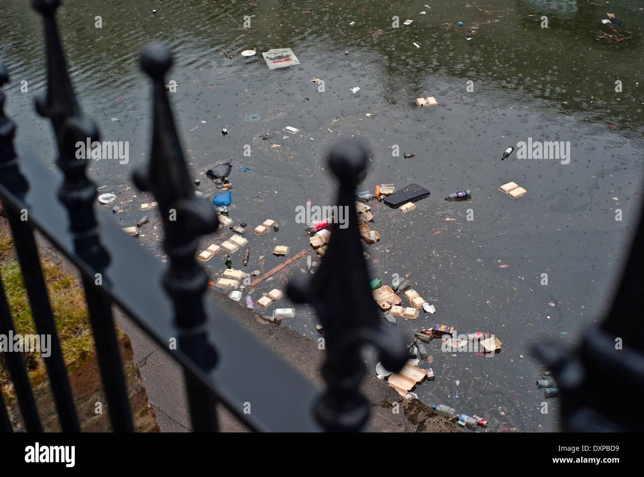 flotsam and jetsam canal through railings - Stock Image