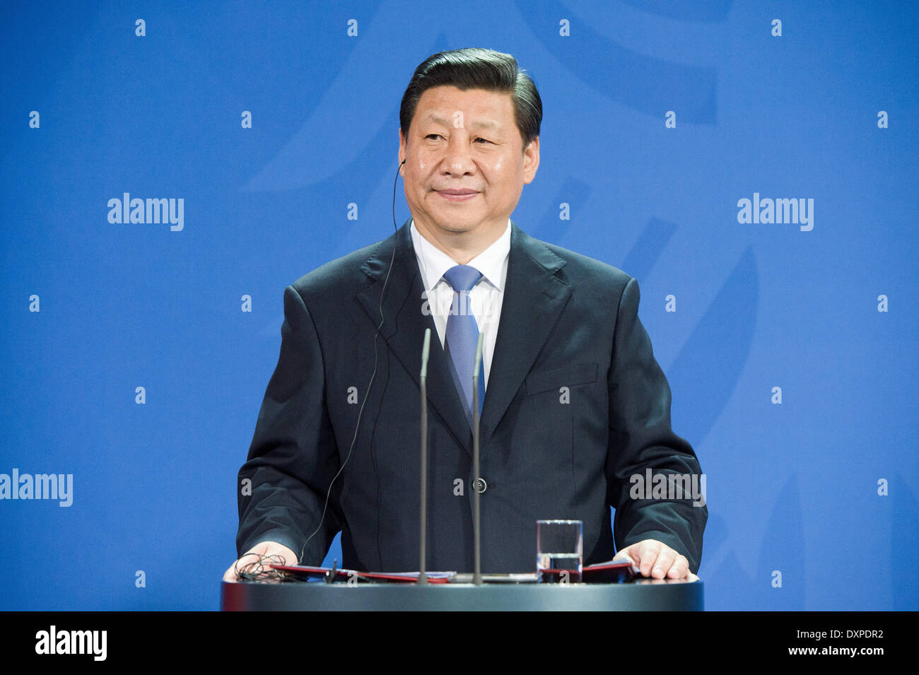 Berlin, Germany. 28th Mar, 2014. Chinese President Xi Jinping looks on during a press conference at the chancellery in Berlin, Germany, 28 March 2014. It is the first state visit of a Chinese President to Germany in eight years. Photo: MAURIZIO GAMBARINI/dpa/Alamy Live News - Stock Image