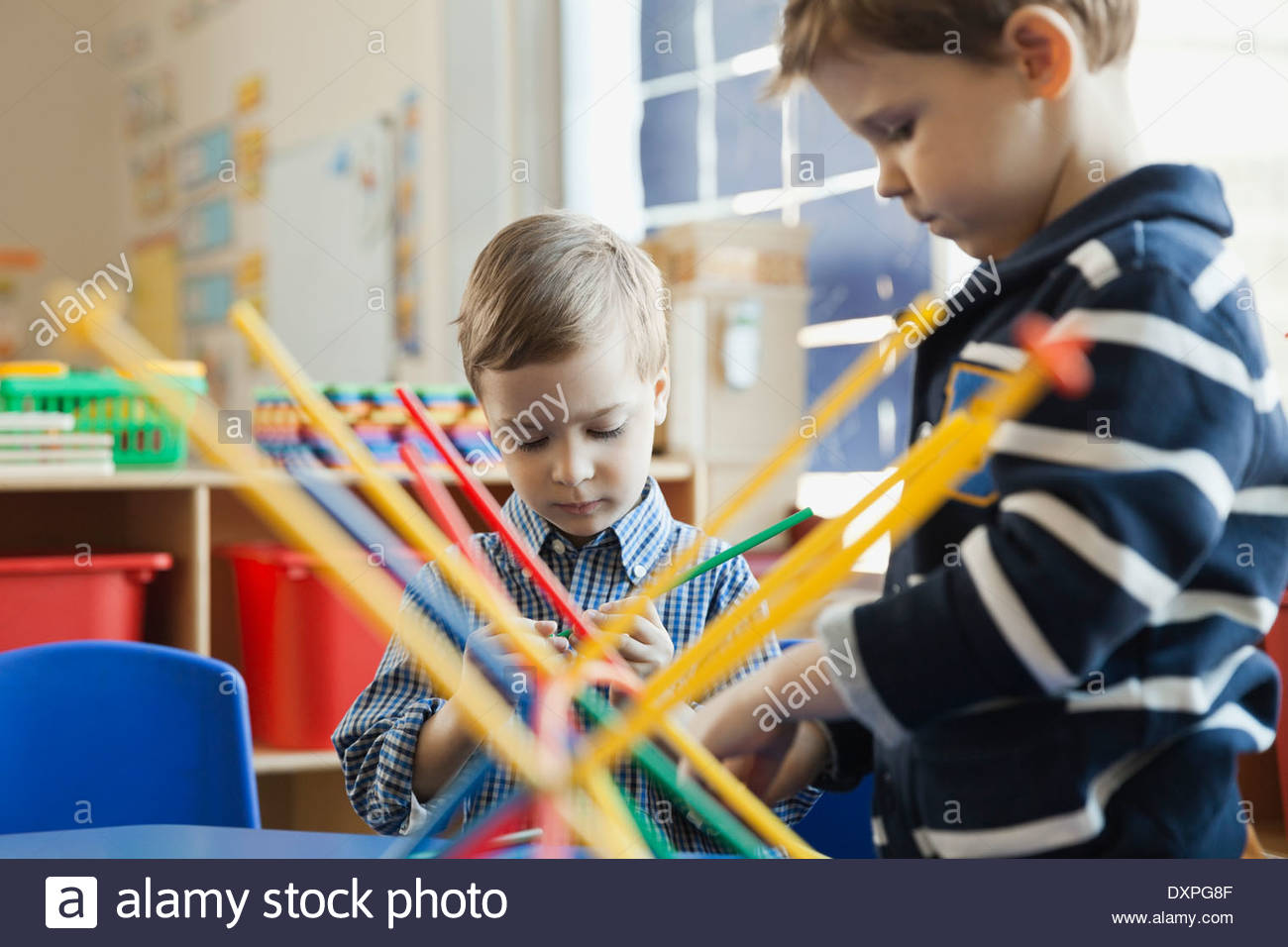Boys playing in elementary school - Stock Image