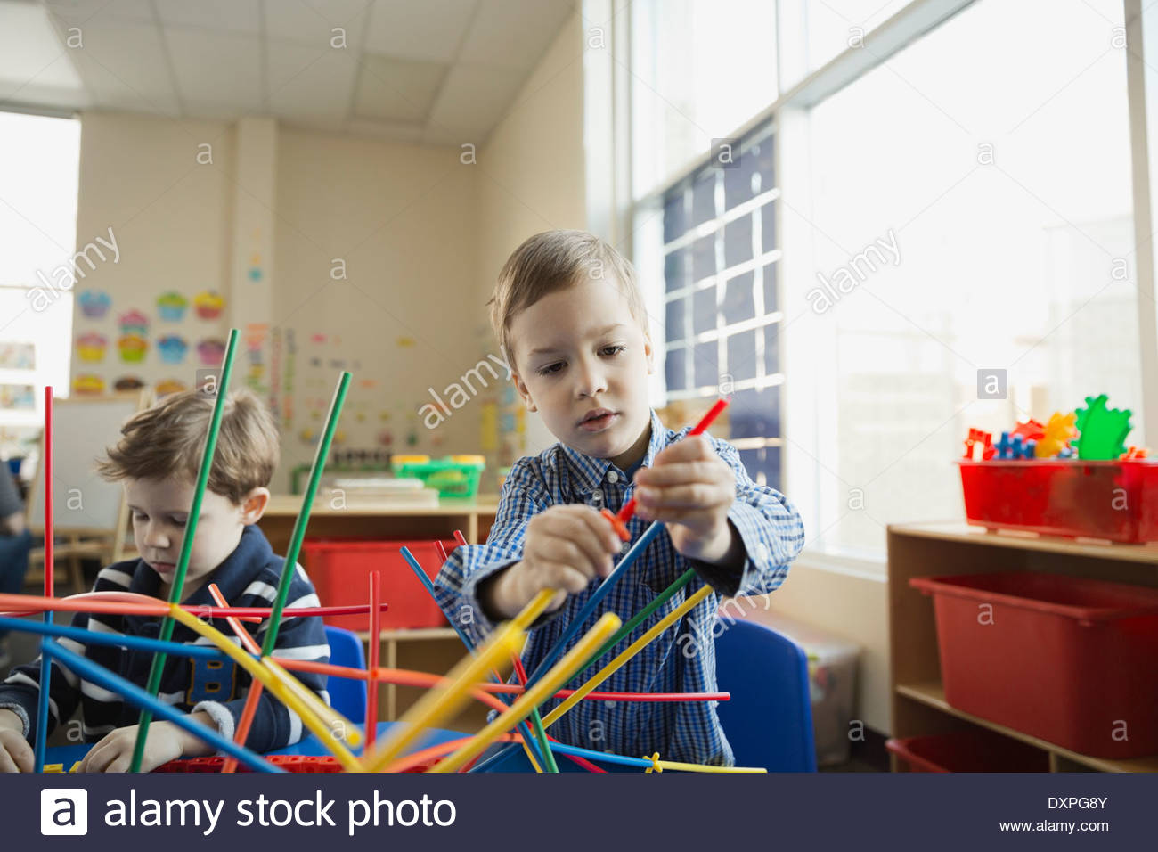 Children playing in elementary school - Stock Image
