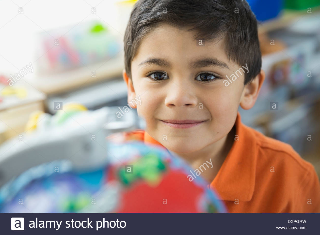 Portrait of smiling boy in school - Stock Image