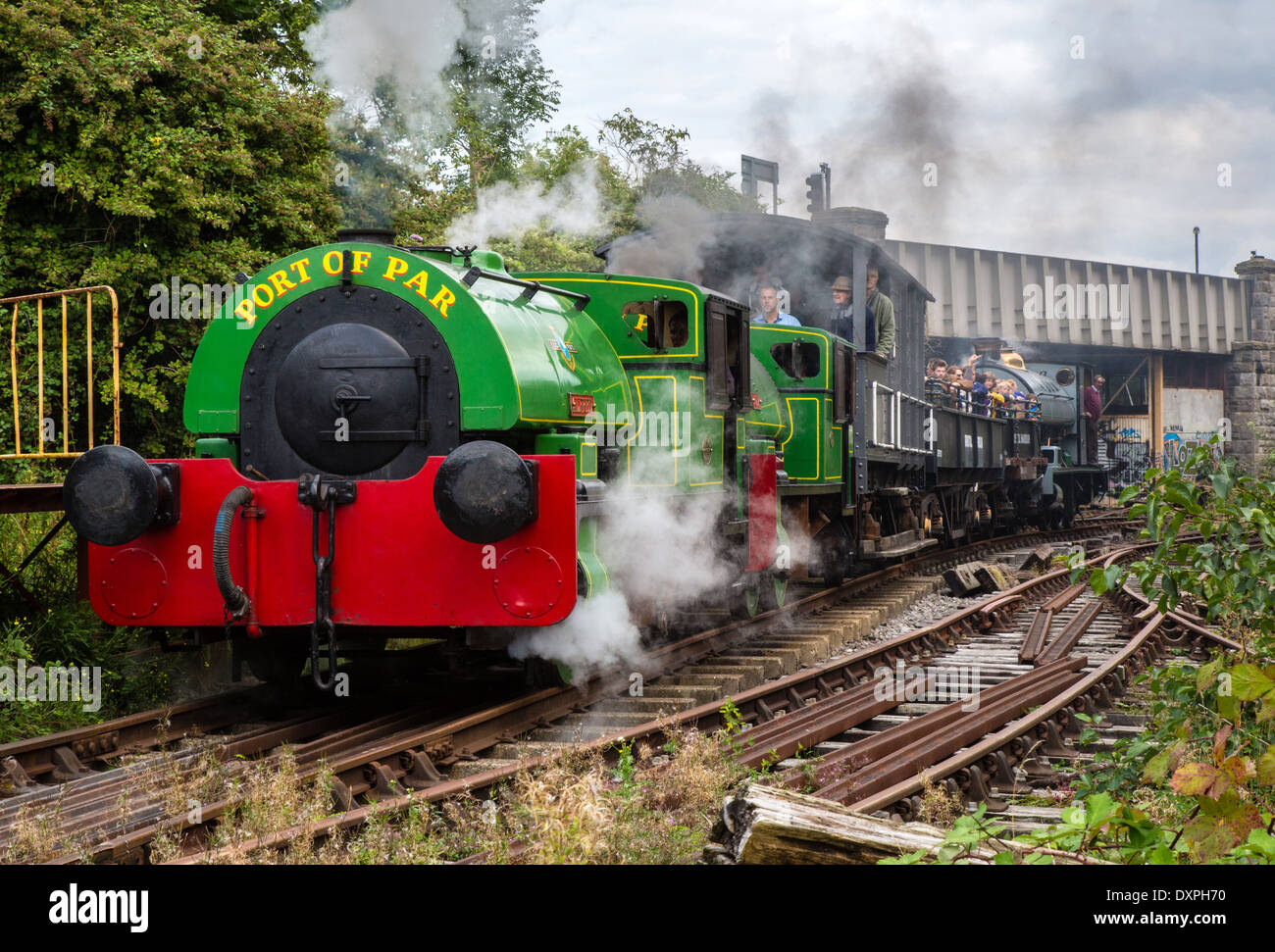 Steam trains pulling carriages along heritage track by the river Avon in Bristol UK - Stock Image