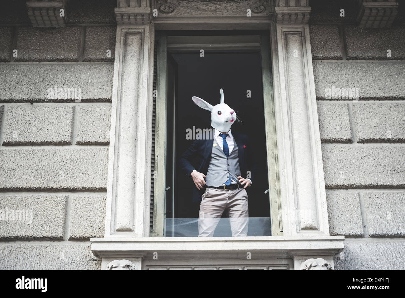 rabbit mask man appeared at the window in the city - Stock Image