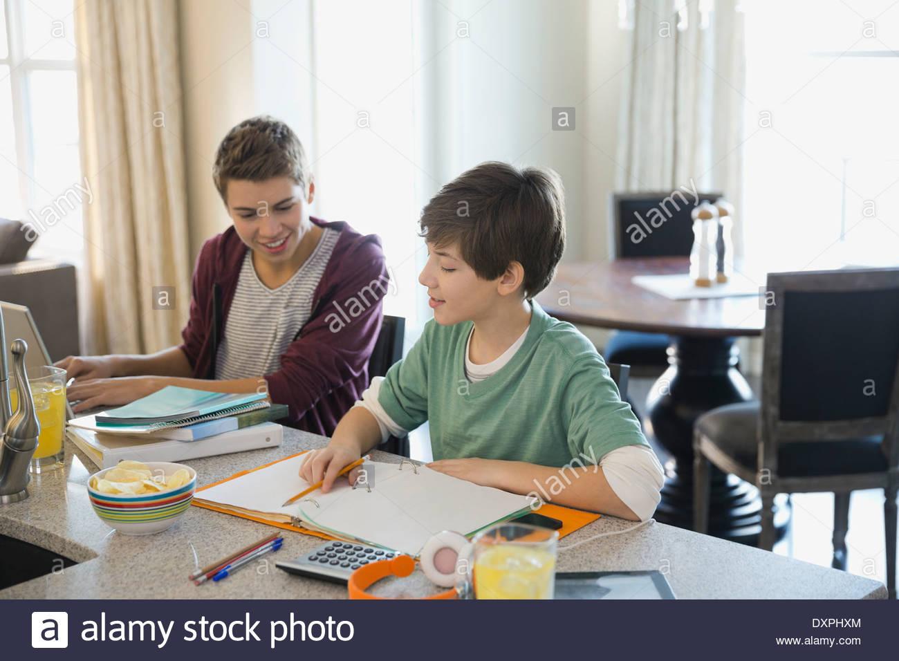 Sibling working on homework - Stock Image