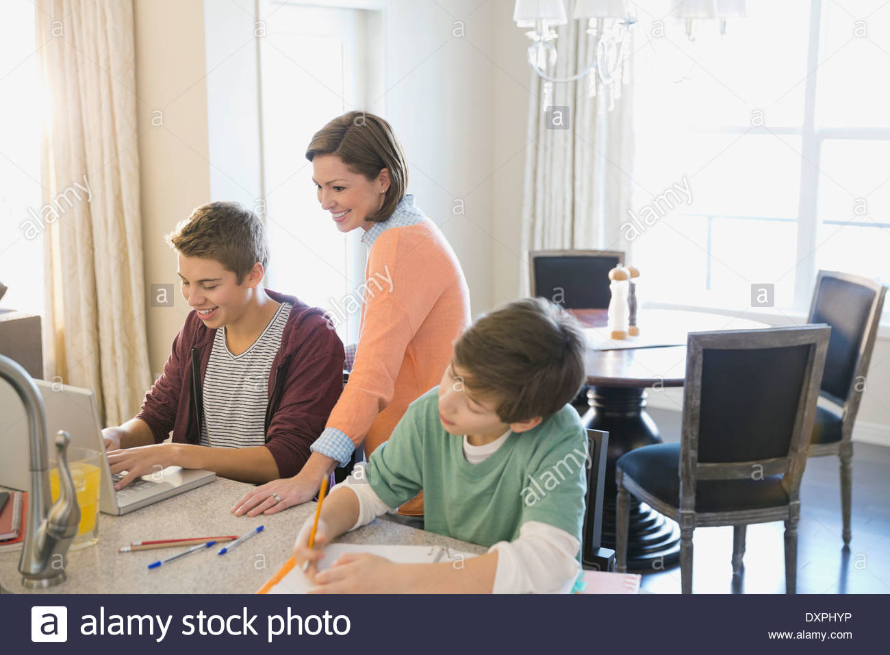 Mother assisting son with homework - Stock Image