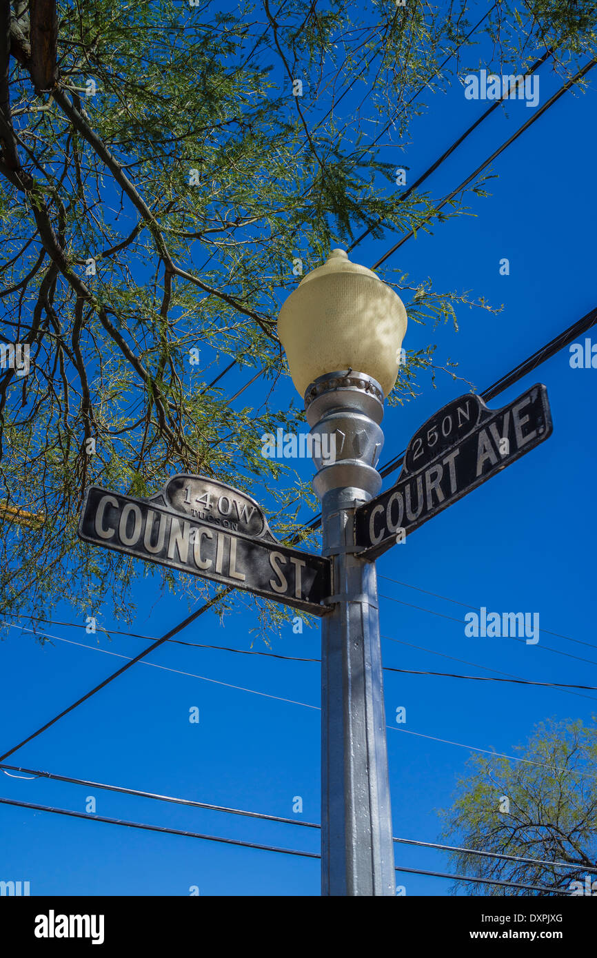 Looking up at a classic style lamp post and street signs on the corner of Council St. and Court Ave. in Tucson, Arizona. - Stock Image