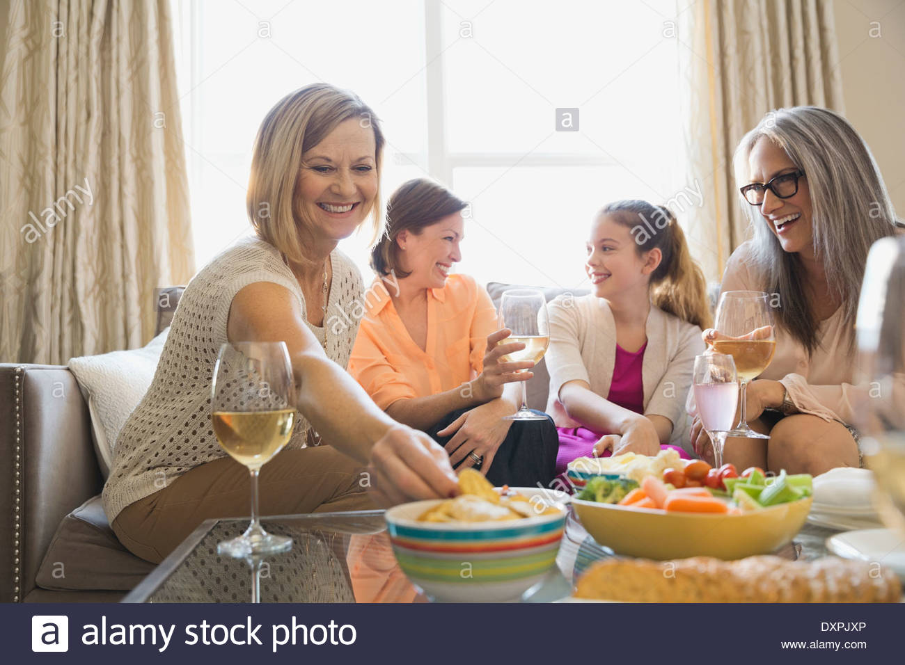 Three generation female enjoying party at home - Stock Image