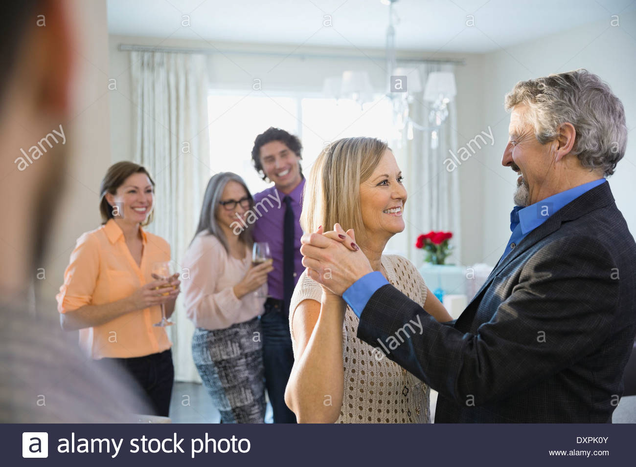Loving couple dancing at party - Stock Image