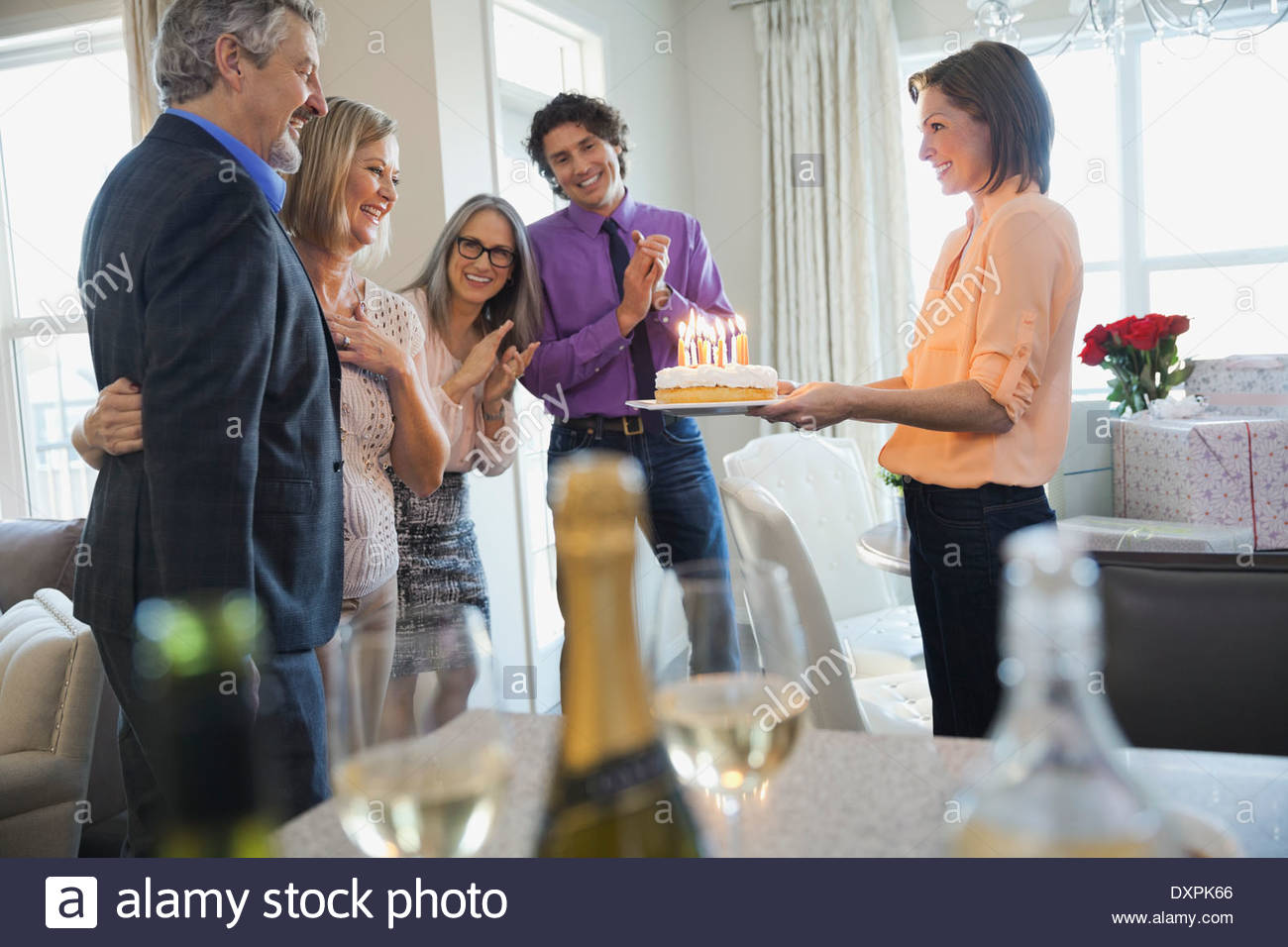 Family and friends celebrating birthday at home - Stock Image