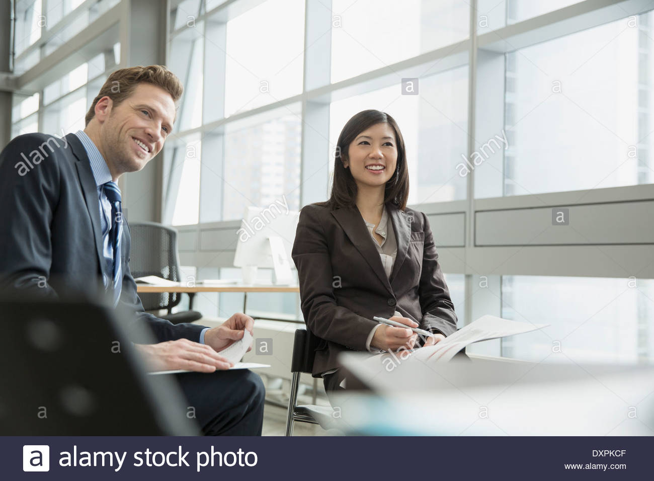 Confident business people in meeting - Stock Image