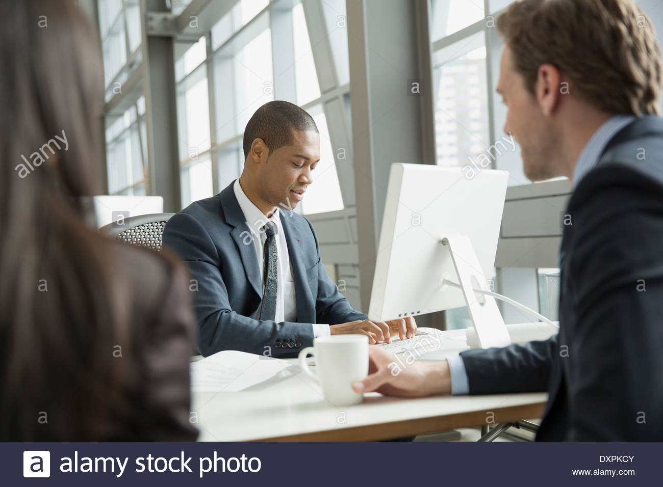 Business people meeting at computer in office - Stock Image
