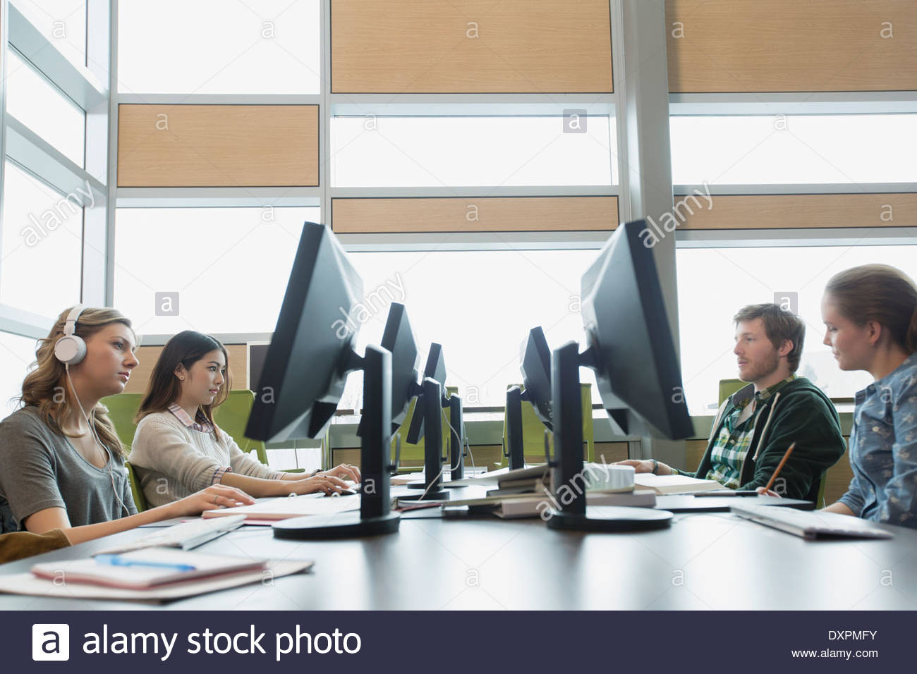College students working in computer lab - Stock Image