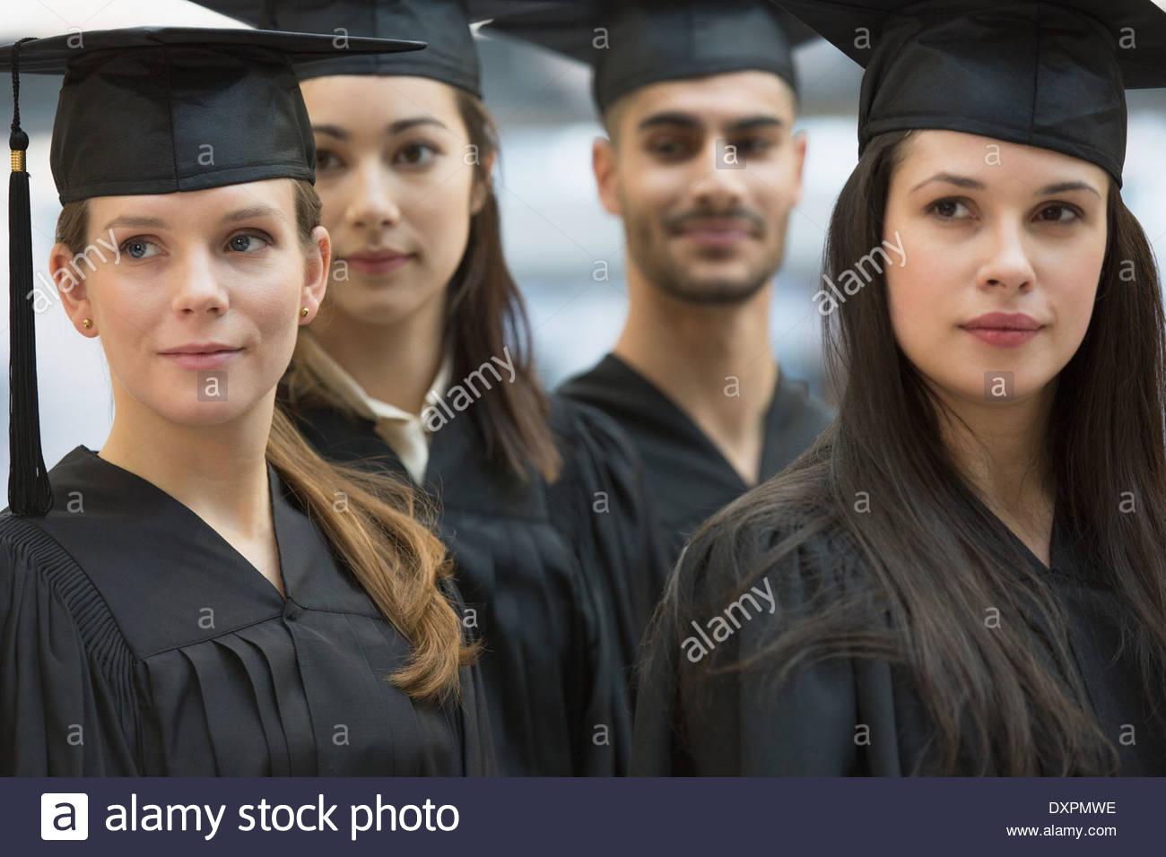 Confident college graduates - Stock Image
